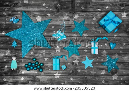 Turquoise or blue christmas decoration on wooden shabby chic background. - stock photo