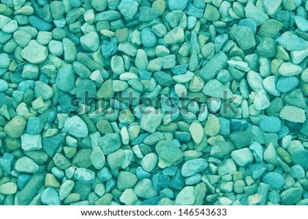 Turquoise pebble background texture - stock photo