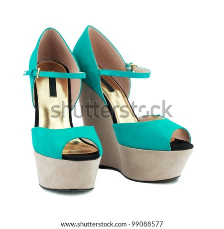 Turquoise shoes over white background - stock photo