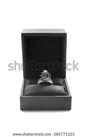 Turquoise silver ring in black box on white background - stock photo