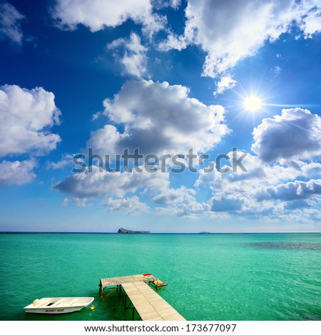 Turquoise water and jetty in tropical Island - stock photo