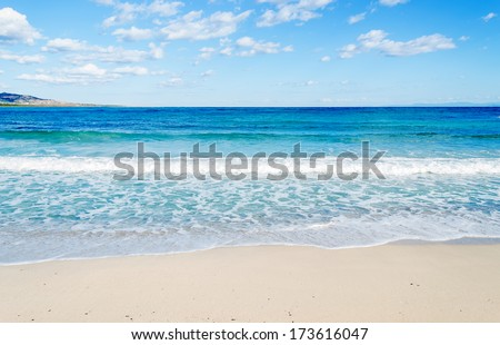 turquoise water in Stintino on a cloudy day - stock photo