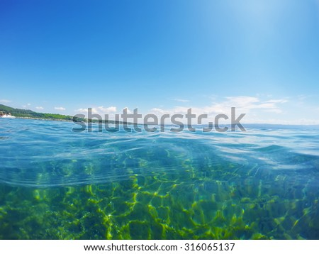 turquoise water seen from surface level in Sardinia, Italy - stock photo
