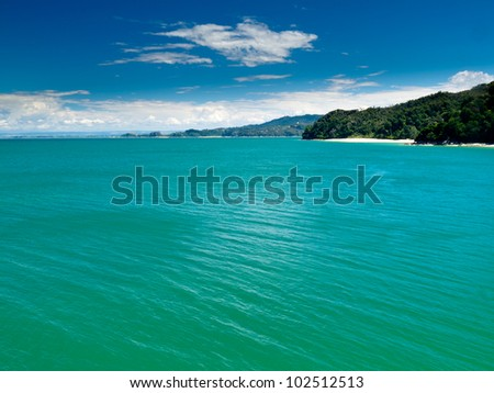 Turquoise waters of Cook Strait off Abel Tasman National Park, South Island, New Zealand - stock photo
