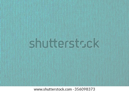 Turquoise with a red background with wood texture. - stock photo