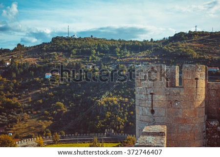 Turret of Braganza Castle and a mountain behind. - stock photo