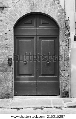 Tuscan door (black and white) - stock photo
