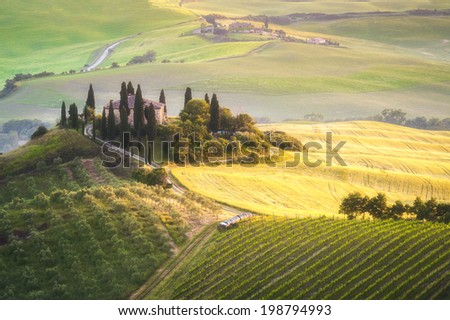 Tuscan house on the misty hills - stock photo