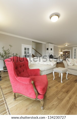 Tuscany - closeup of a red armchair in living room - stock photo