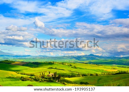 Tuscany, farmland and cypress trees country landscape, green fields. San Quirico Orcia, Italy, Europe. - stock photo