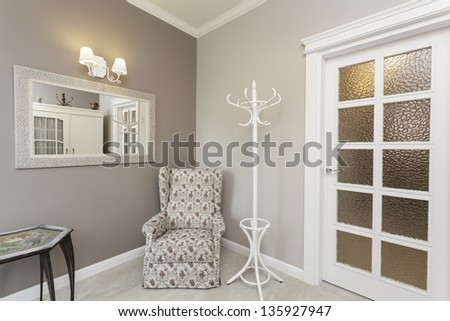 Tuscany - floral stylish armchair in corner of room - stock photo
