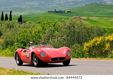 """TUSCANY, ITALY - MAY 13: unidentified drivers in old Fiat transit during the stage Bologna-Roma of the """"Mille miglia"""" historical race for classic cars, on May 13, 2008 in Tuscany, Italy - stock photo"""