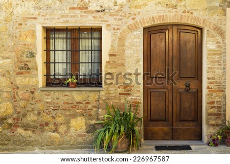 Tuscany, Italy - old vintage town street - door and window - stock photo