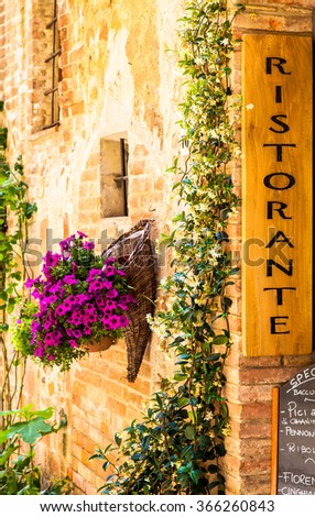 Tuscany, Italy. Sightseeing of Italian Restaurant in traditional small village in Val Orcia - stock photo