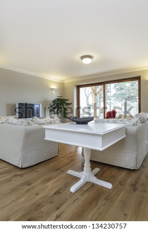 Tuscany - white furniture in beige living room - stock photo