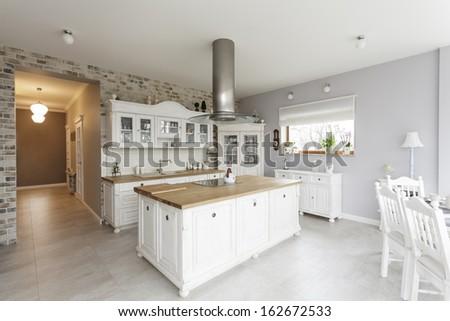 Tuscany - white furniture in luxury kitchen - stock photo