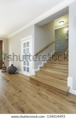 Tuscany - wide and wooden stairs, bright interior - stock photo