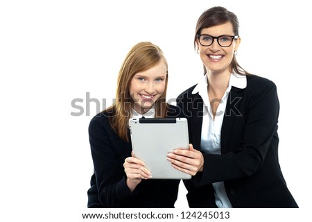 Tutor with student holding portable tablet pc. Technology and education concept. - stock photo