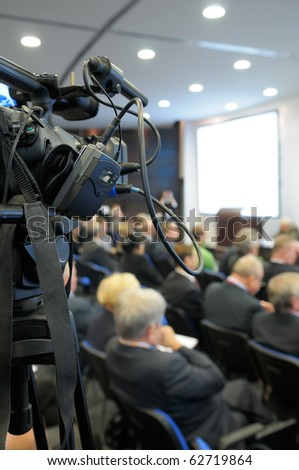 TV camcorder at a conference. - stock photo