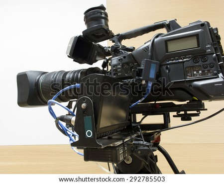 tv camera in a concert hall  Professional digital video camera  - stock photo