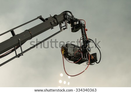TV camera on a crane on football mach or concert - stock photo
