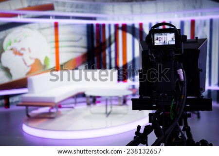 TV morning program studio with camera and lights. Video camera lens - show in TV studio. Television studio with interior and and positioned camera . - stock photo