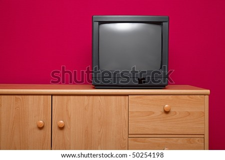 TV on a cabinet - stock photo