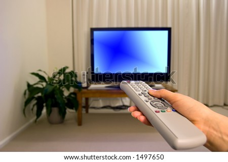 TV remote control and blurred background, shallow focus - stock photo
