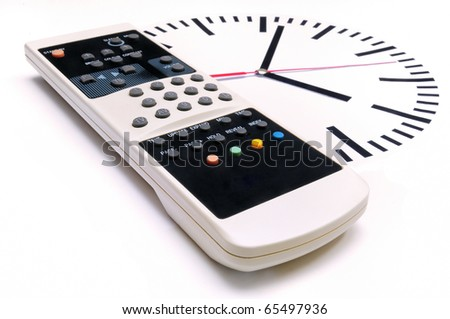TV Remote Control and clock on white background - stock photo