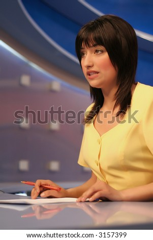 TV reporter presenting the news in studio - stock photo