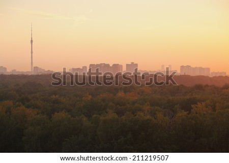 TV tower and urban houses in summer yellow sunrise in early morning, Moscow - stock photo