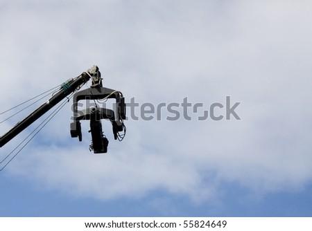 TV video camera above the blue sky. - stock photo