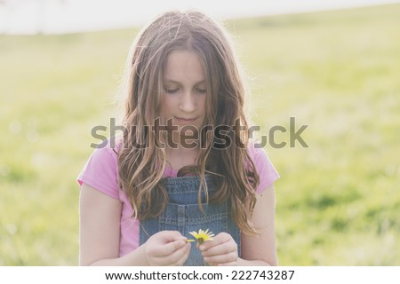 tween girl with daisy - stock photo