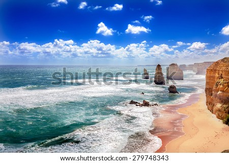 Twelve Apostles and orange cliffs along the Great Ocean Road in Australia - stock photo