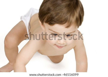 Twelve month old baby boy crawling on a white background - stock photo