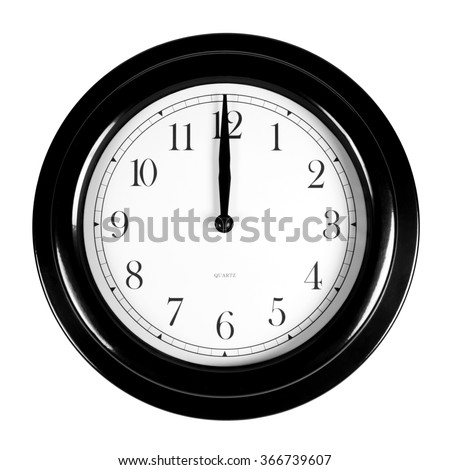 Twelve o'clock on the black wall clock, isolated on white background - stock photo