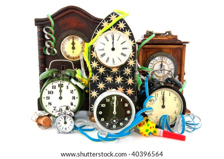 Twelve O'Clock with fireworks at new years eve - stock photo