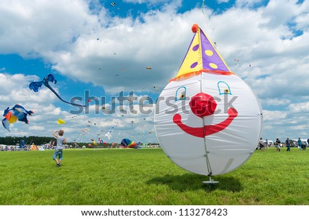 TWENTERAND, NETHERLANDS - JUNE 30: Colorful kites at the 3rd international kite festival on june 30, 2012 in Twenterand, Netherlands.Most of the participants are from Germany and Belgium. - stock photo