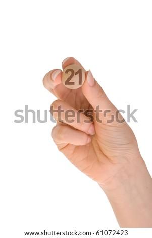 twenty first bingo ball in the hand - stock photo