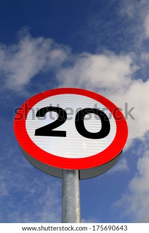 Twenty mile per hour street sign with blue skies in background. - stock photo