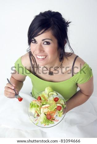 Twenty Something Female eating healthy food salad lunch on white background - stock photo