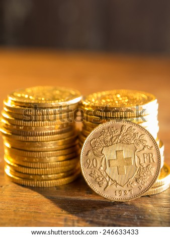 Twenty Swiss Francs gold coins - stock photo