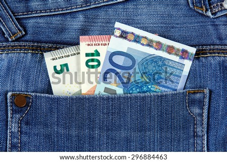 Twenty, Ten and Five Euro Bank Banknote in the pocket of jeans. European Union.  Background, texture - stock photo