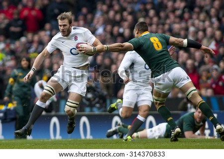 TWICKENHAM LONDON, 27 NOVEMBER 2010.  England's Tom Croft evades the tackle of South Africa's Pierre Spies, during the Investec International match between England and South Africa - stock photo