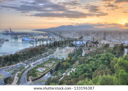 Twilight aerial view of Malaga city, the second most populous city of Andalusia and the sixth largest in Spain.Malaga's history spans about 2,800 years,making it one of the oldest cities in the world. - stock photo