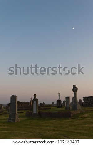 Twilight at graveyard in Stornoway - stock photo