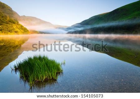 Twilight at Upper Lake in Glendalough Scenic Park, Ireland - stock photo