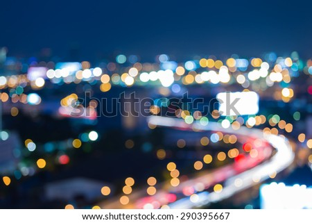 Twilight city road curve, abstract blur bokeh background - stock photo