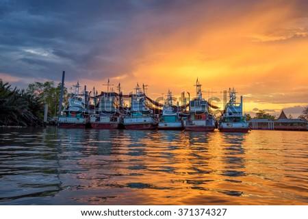 Twilight fishing boat at harbor in bay,Thailand - stock photo