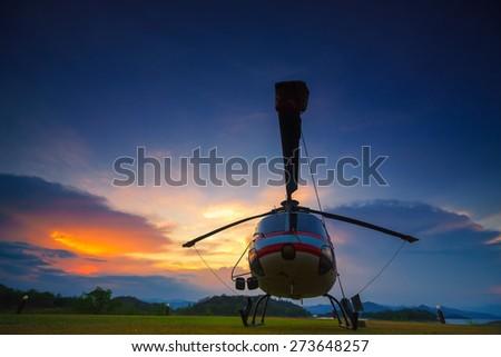 Twilight helicopter on the helipad. - stock photo